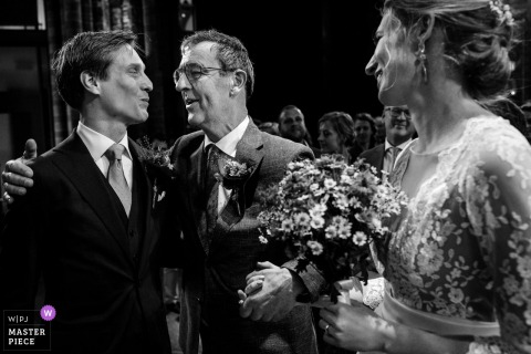 Vondelkerk Amsterdam photography - Wedding image of the father of the bride with bride and his son in law.