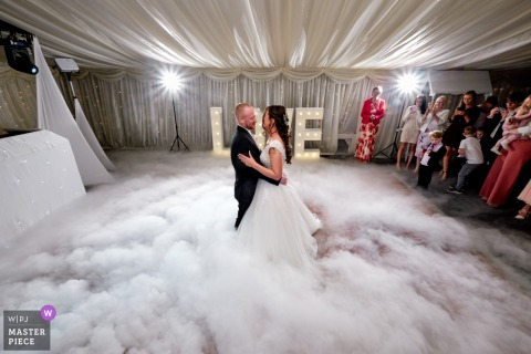 Wedding Photography from Bordesley Park - Bride and groom dancing on the clouds during their first dance
