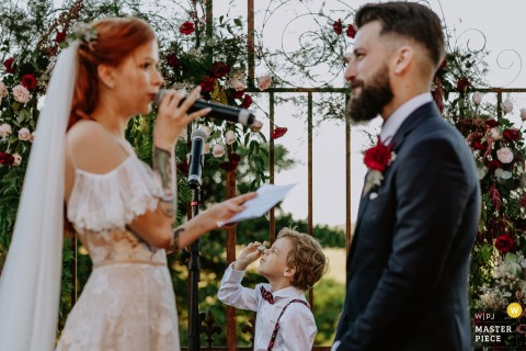 The bride reads her vows to the groom at Vinicola Laurentia in this award-winning wedding photo taken by a Rio Grande do Sul, Brazil photographer