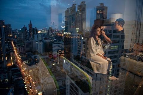 Vutiporn Supanish, of Bangkok, is a wedding photographer for Holiday Inn Sukhumvit