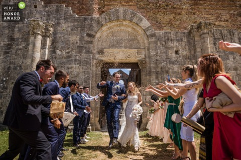 San Galgano Abbey, Siena wedding photo from after the ceremony | Jumping during confetti!!!