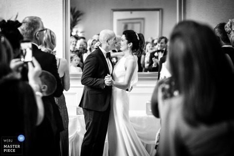 Wedding photo from Faithlegg House Hotel & Golf Resort - A candid moment after the ceremony and guests cheers at the mirror