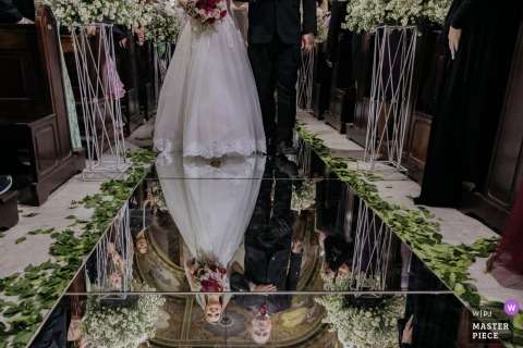 Ceremony Photograph Santo André Igreja Matriz do Carmo  - The bride entering the church (in Brazil some brides choose these walkways of mirrors). detail of the contact with the father on the upper plane, and the smile on the bottom when seeing the groom