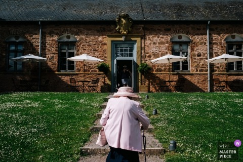 Wedding Photography at Hestercombe House - The Bride's grandma makes her way into the reception