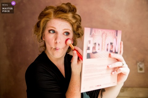 Photo of a North Lake Tahoe Bride putting on her own makeup