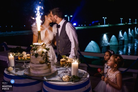 Photography at The Bridge Restourant - Svilengrad, Bulgaria - The Cake kiss at the reception