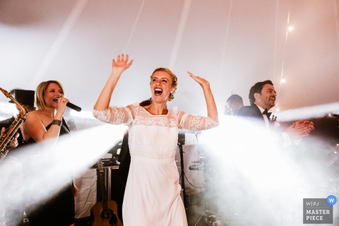 The bride appears as if beams of light are bursting from her as she dances at her Provence wedding in this photo by a documentary-style PACA, France photographer.
