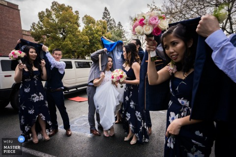 "Stockton Wedding Photographer: ""It was raining when preparing for the ceremony."""