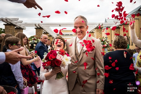 Kasteel Dussen - Netherlands Wedding Photograph showing that kids will be kids - throwing of flower petals after ceremony