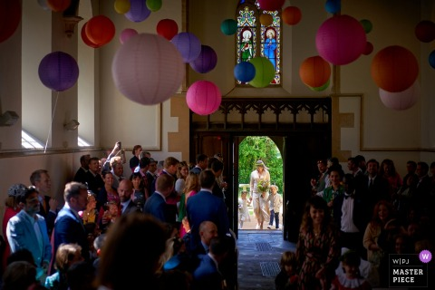 Plush Manor, Dorset, UK Photography | Bride enters the chapel, with her children during ceremony