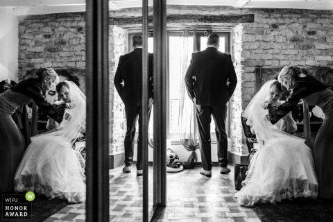 Wedding reflection image of the bride sitting near mirrors