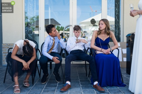 De Lelie, Veurne wedding venue photography of kids dressed up and relaxing.