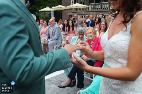 Wassenaar Wedding Photos - two grandmothers enjoying the ring ceremony