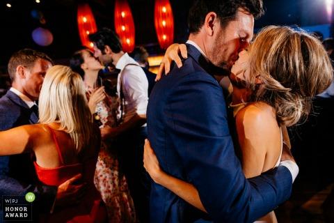 Erfgoed Bossem wedding venue photography   3 hugs at the same time at the dancefloor