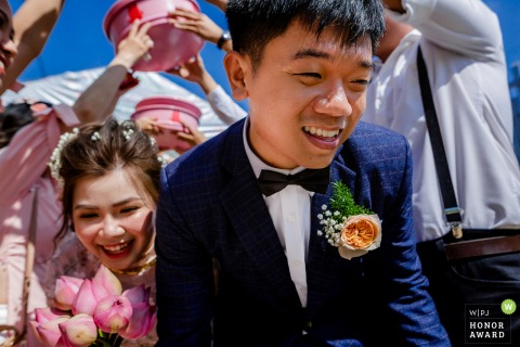 Tra Vinh - Viet Nam actual wedding day photography | The bride and groom took each other's hands and ran through the bridesmaids and groomsmen