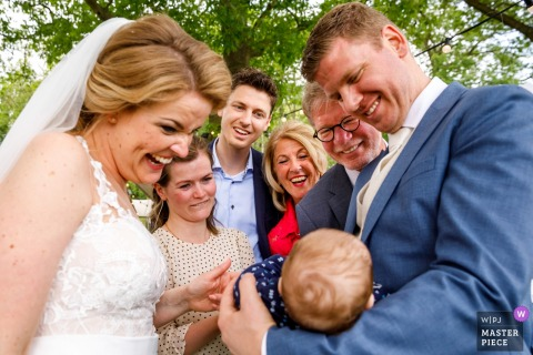 Delden - Hoeve de Haer Post Ceremony Wedding Photo - Warm welcome to the new family member