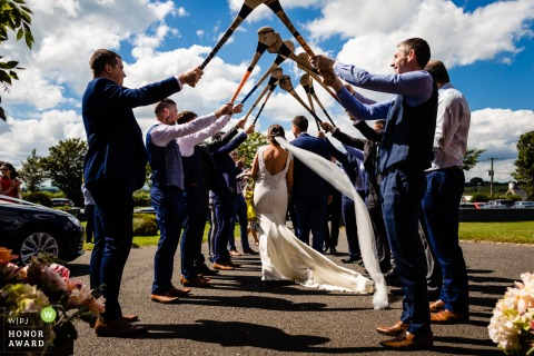 Tipperary, Ireland wedding photos at the Ashley Park House | Guard of honour with hurley sticks