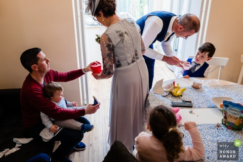 Medley, Dublin, Ireland Wedding Reportage Photo - Feeding and dressing the kids on the wedding morning