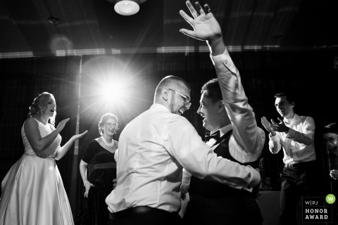Burlesque Ballroom wedding venue photography - Groom and godfather dance during the reception party