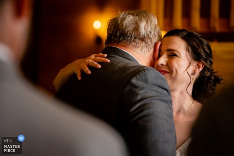 Stoneyman Ranch, Luray, Virginia Wedding Photography | bride hugs her father after he walks her down the aisle
