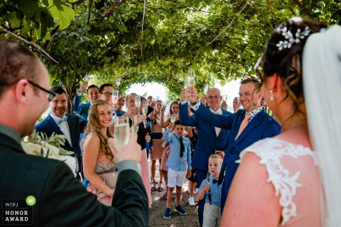 Italy - Borgo Petrognano - Barberino Val D'elsa wedding venue photography of a Happy toasting moment