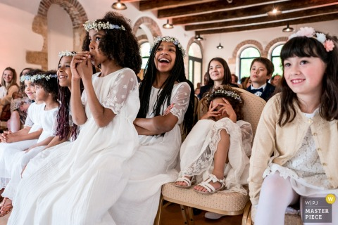 Wedding photo of children laughing during ceremony at Château d'Azy