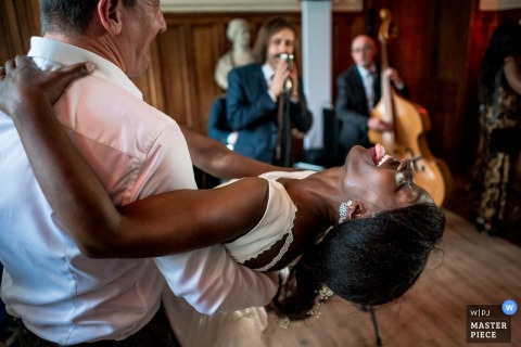 Bride dancing during reception at the Château d'Azy - Wedding Reception Photography