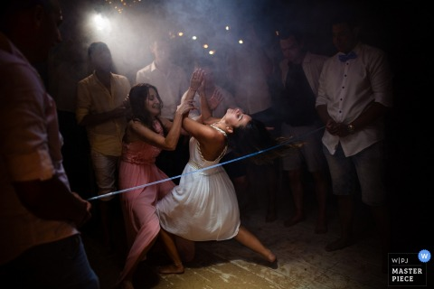 Iguana Bar, Sozopol, Bulgaria Wedding Venue Photos - The Bride and the Limbo dance on the dance floor