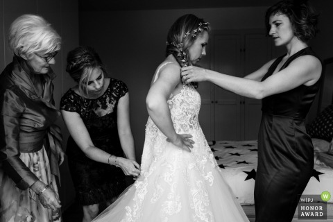 Landgoed Salentein photo of the dress going on   The bride getting ready with mother and sisters