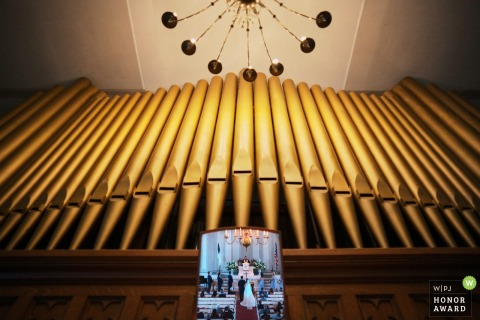 1st congregational church nantucket wedding photo of the bride and groom reflected in the pipe organ mirror