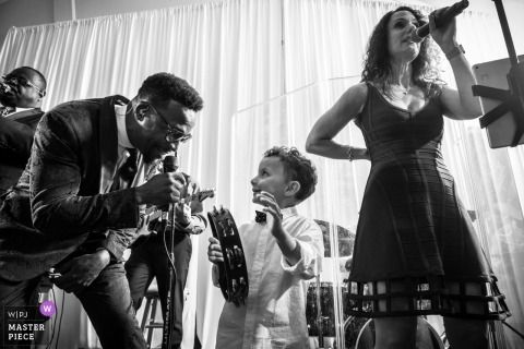 Orchard Lake Country Club - Orchard Lake, MI Wedding Venue Photography - Ring Bearer finds his rhythm with the live band