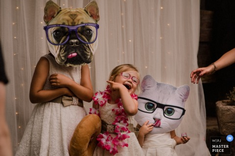 Children play with large cutouts of cats and dogs during the ceremony in Baserri Maitea, Spain in this award-winning photo by a Gipuzkoa, Biscay documentary wedding photographer.