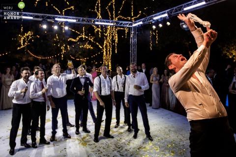 Garda Island - Italy wedding venue photos - The Groom Throwing the garter