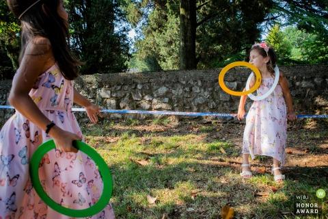 Castelvecchio - Sagrado wedding photojournalism - Kids playing during the reception