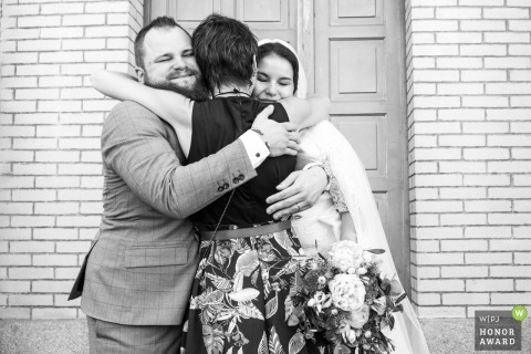 Chaptelat wedding photography   Hugs after the ceremony at the townhall