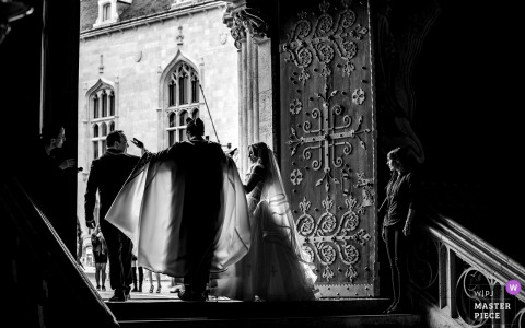 Holdudvar, Casino Budapest Wedding Photo in Black and White - After the ceremony, the priest give way for the couple