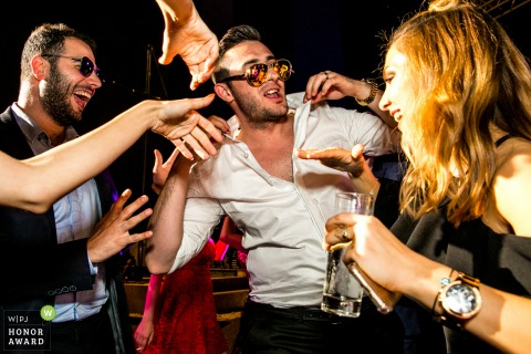 Wyndham Ankara wedding venue photography - Groom wearing sunglasses on the dance floor