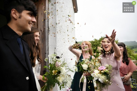 Barmolloch, Argyll, Scotland wedding day photography | Being caught out as the couple had no idea there was confetti waiting for them