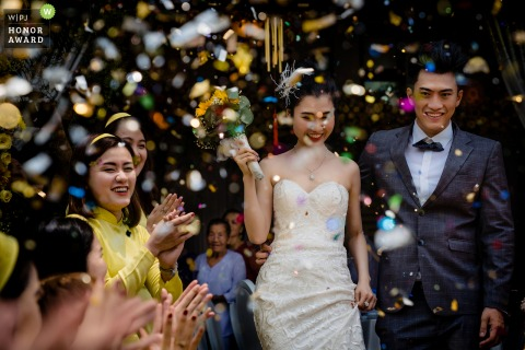 Binh Duong wedding photo from the Bride's house | The happiness of couple in laughing and cheering of friends and family.