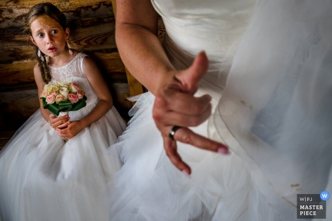 The flower girl looks in shock at the bride in Balen who accidentally got dirt on her veil in this award-winning wedding photo captured by an Antwerpen, Flanders photographer.