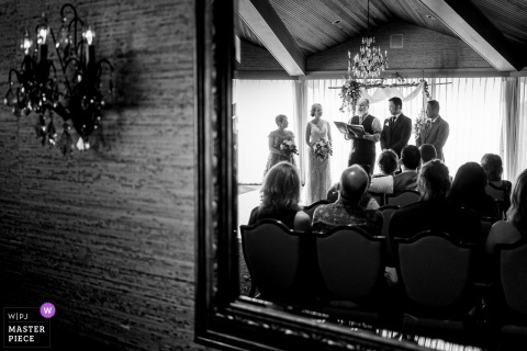 Edgewater Hotel wedding ceremony photo reflection through mirror