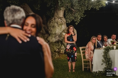 Puglia wedding reception of bride dancing with her father at an outdoor wedding event.
