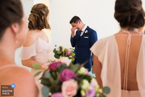 The reefs resort and club Bermuda Wedding photo of groom crying after seeing bride