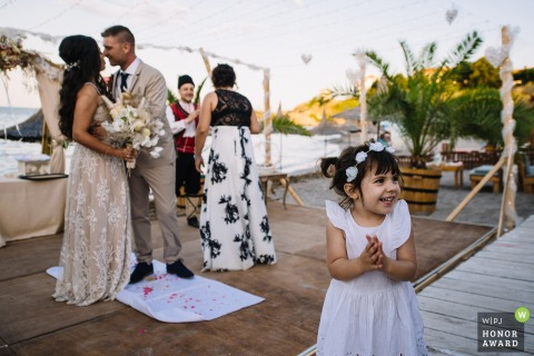 Castro Beach, Tsarevo, Bulgaria wedding venue photography outside | Happy little girl and the newlyweds