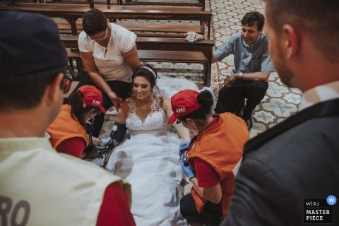 Bride is getting medical attention from the fire department after fainting during her wedding at Igreja Matriz Nossa Senhora da Conceição