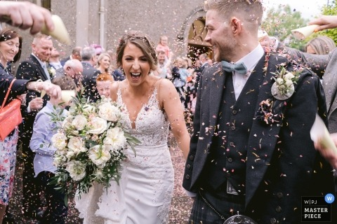 Leighinmohr House Wedding Ceremony Photographer | Bride and Groom exit church in confetti run