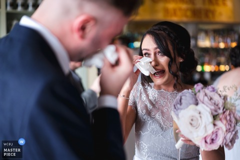Orange Tree House, Greyabbey, Northern Ireland Documentary wedding photography | Groom and his sister emotional after the ceremony