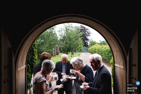 Lissanoure Castle, Glens of Antrim Wedding Venue -  Photography of Irish guests enjoying a cup of tea