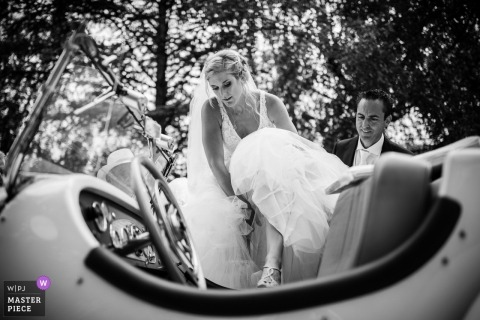 Genève, Switzerland - Wedding photo showing it's not easy to get into the old timer