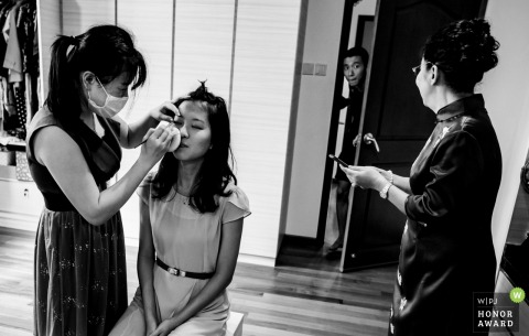 Singapore wedding photo during getting ready | Asking mum where his tie is